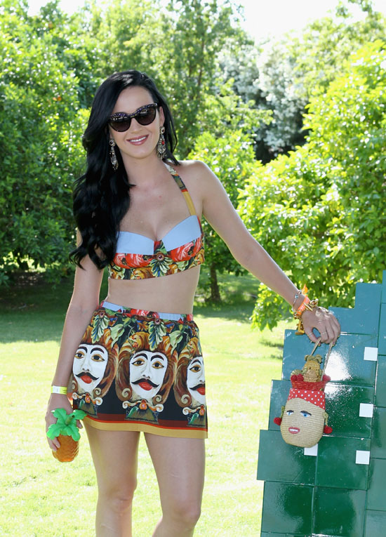 Katy Perry carrying a straw Carmen Miranda bag by Lulu Guinness (complete with cherry earrings and pineapple hat).